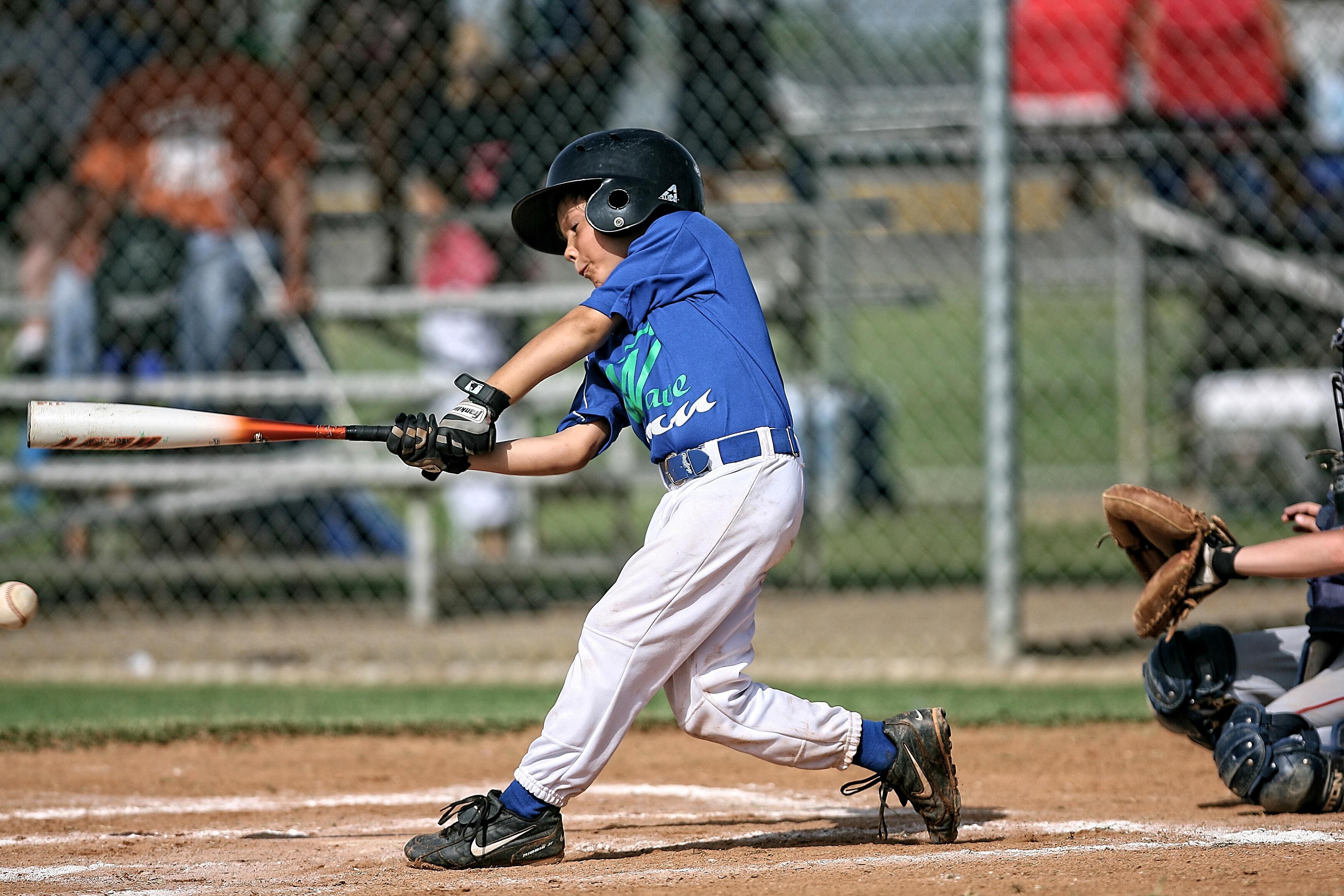 Kid hitting baseball